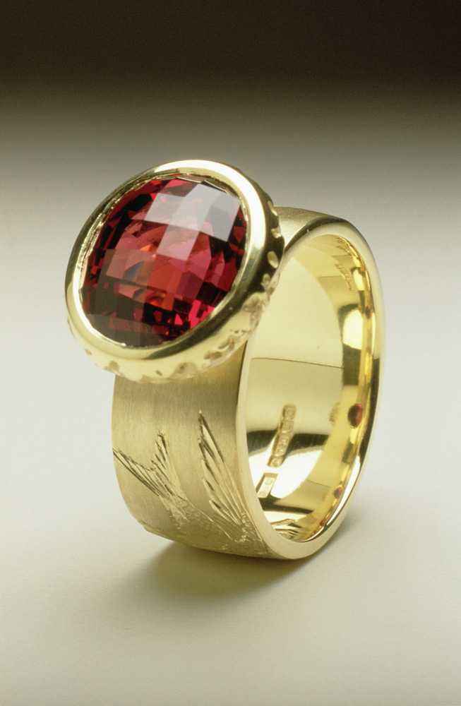 "<a href=""/jewellery/house-martin-ring-18ct-green-gold-hand-engraved-oval-chequerboard-cut-garnet"">'House Martin' Ring, 18ct green gold, hand engraved, oval chequerboard cut garnet.</a>"