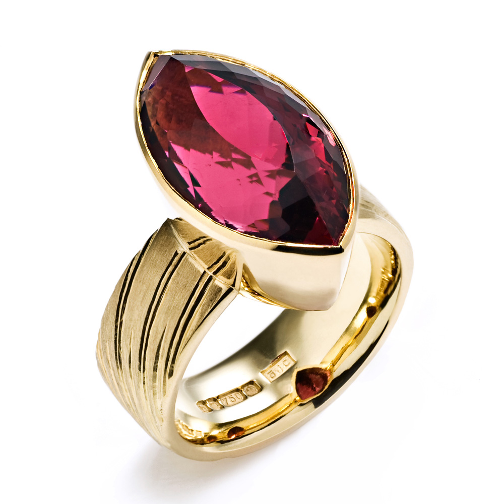 "<a href=""/jewellery/ring-10"">Dress Ring, 2008. 18 ct gold, shank engraved with rising sun motive. Set with marquise rubelite tourmaline. Photo : Simon Armitt</a>"