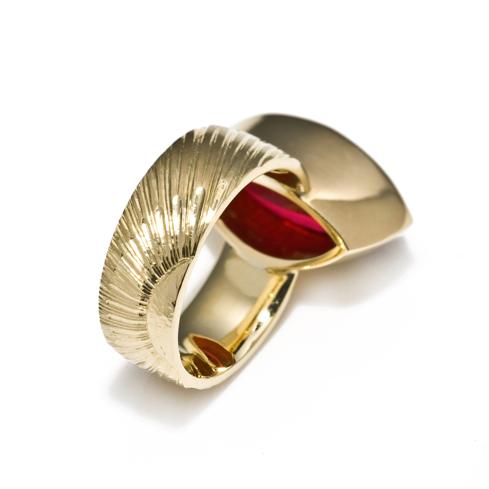 "<a href=""/jewellery/reverse-detail-2"">Reverse detail: Dress Ring, 2008. 18 ct gold, shank engraved with rising sun motive. Set with marquise rubelite tourmaline. Photo : Simon Armitt</a>"