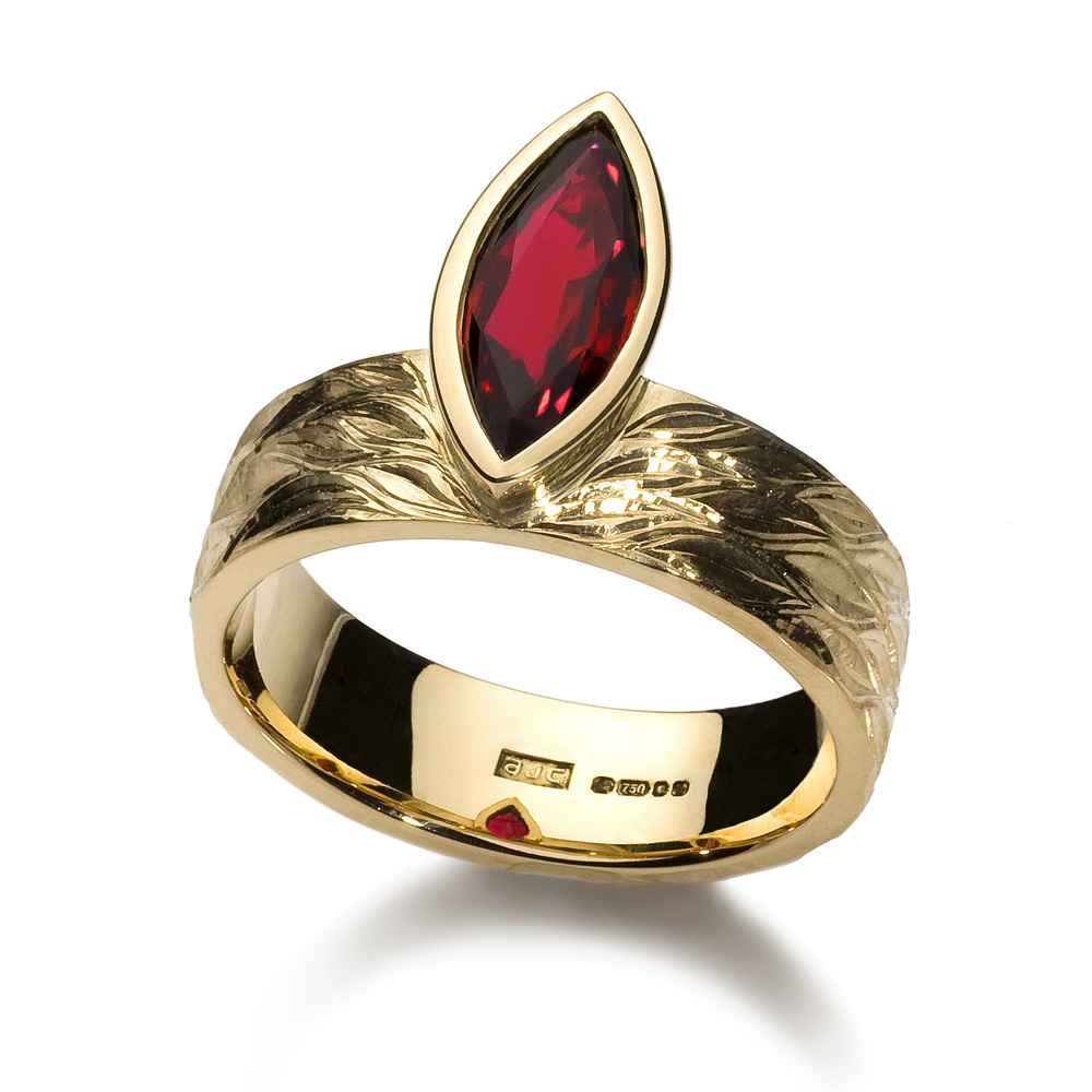"<a href=""/jewellery/ring-9"">Engagement ring, 2008/9. 18 ct yellow gold, ring shank hand engraved, marquise ruby. Photo : Simon Armitt. </a>"
