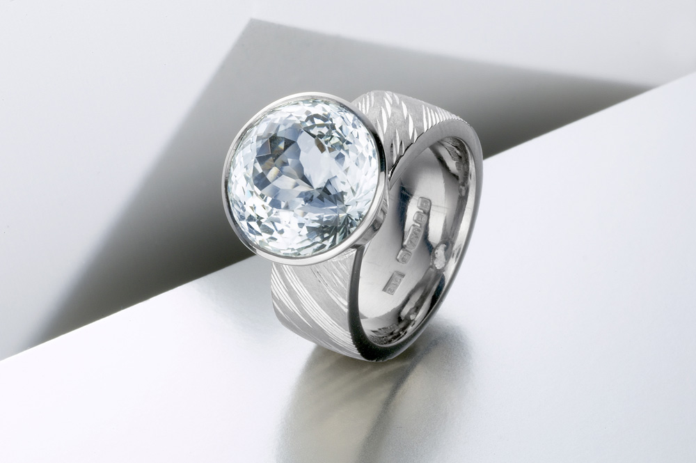 "<a href=""/jewellery/ring-5"">'Air' Dress ring, hand engraved, 18ct white gold, royal cut aquamarine. Photo: Paul Hartley</a>"