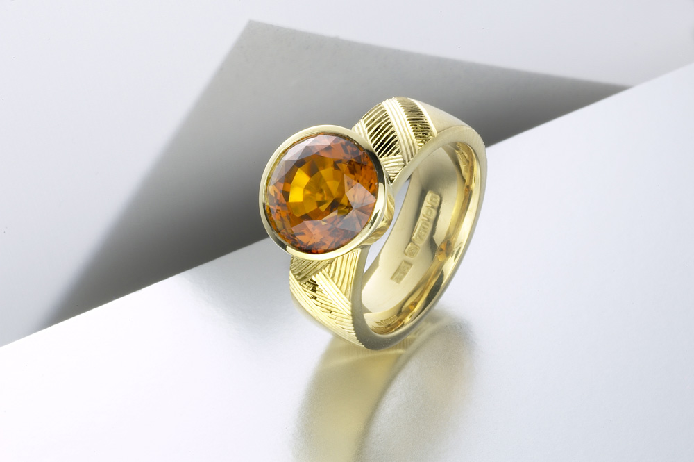 "<a href=""/jewellery/ring-4"">&#039;Earth&#039; Dress ring, hand engraved, 18ct yellow gold, brown green tourmaline. Photo: Paul Hartley</a>"