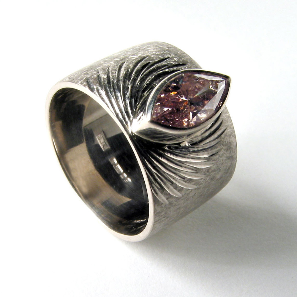 "<a href=""/jewellery/ring-3"">Dress ring, 18ct white gold, hand engraved, pink marquise diamond.</a>"