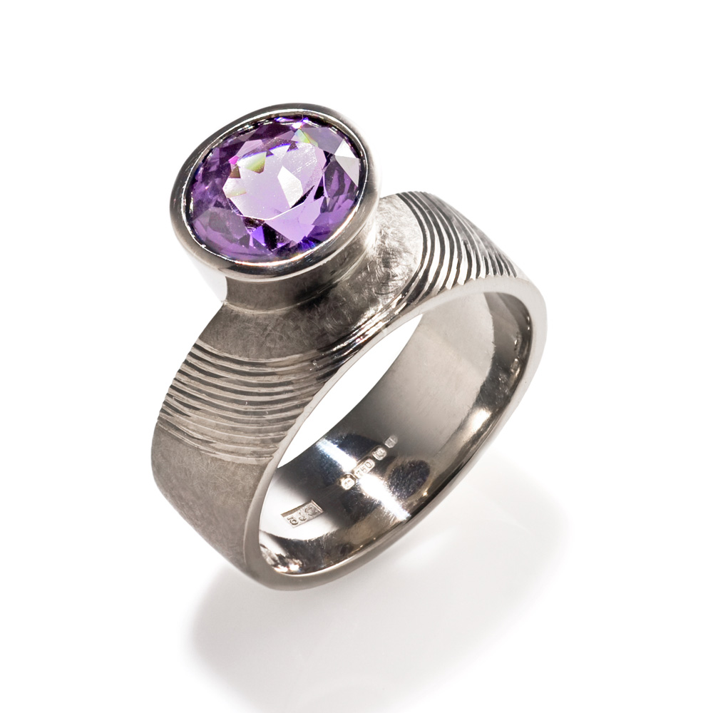 "<a href=""/jewellery/ring-1"">Dress Ring, 2008. 18 ct white gold, shank hand engraved, set with oval cut mauve spinel. Photo : Simon Armitt</a>"