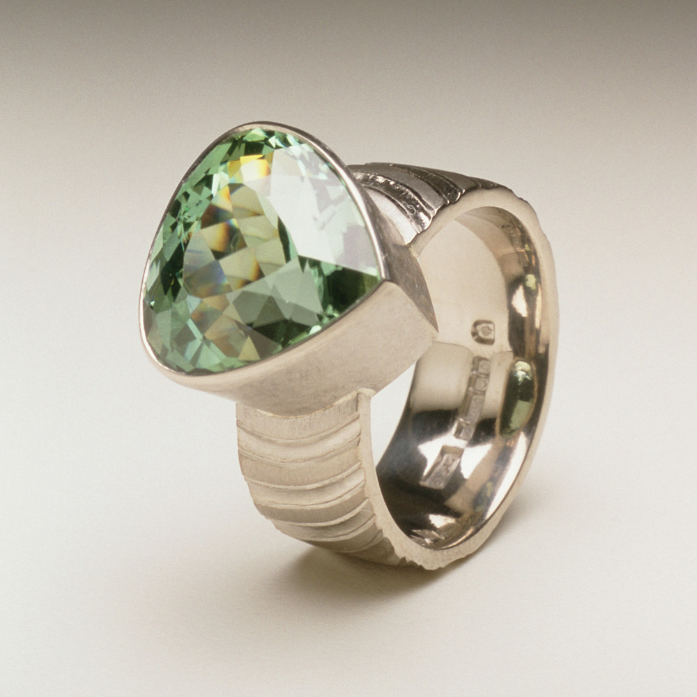 "<a href=""/jewellery/ring-18"">Dress ring, 18ct white gold, hand carved and engraved, pale green tourmaline.</a>"