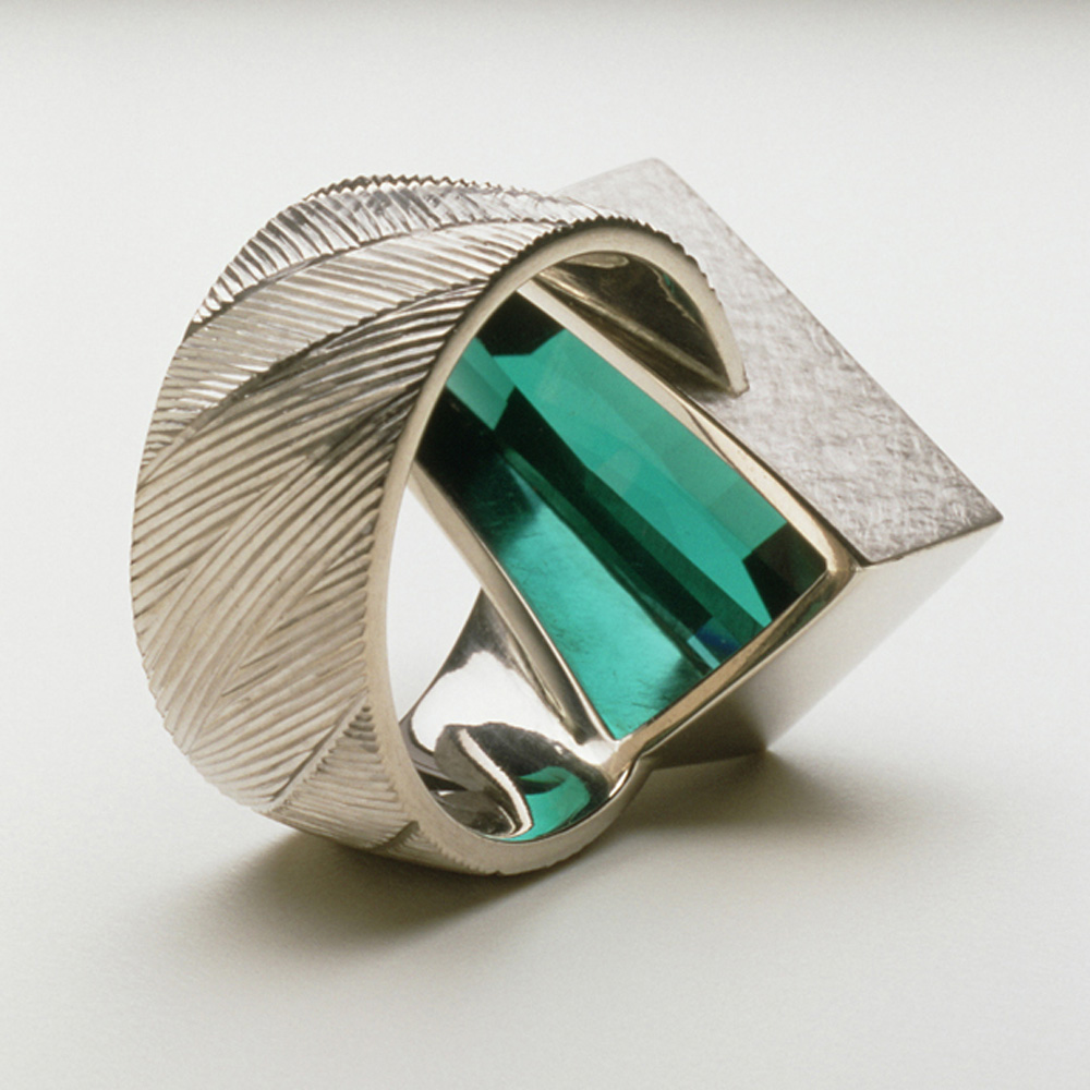 "<a href=""/jewellery/reverse-detail-6"">Reverse detail: Dress ring, 18ct white gold, hand engraved, rare blue tourmaline. Commission piece. Photo: Joel Degen</a>"