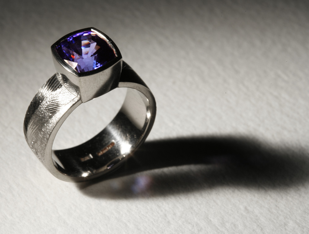 "<a href=""/jewellery/ring-11"">Dress ring, 18ct white gold, hand engraved, tanzanite. Photo: Andra Nelki</a>"