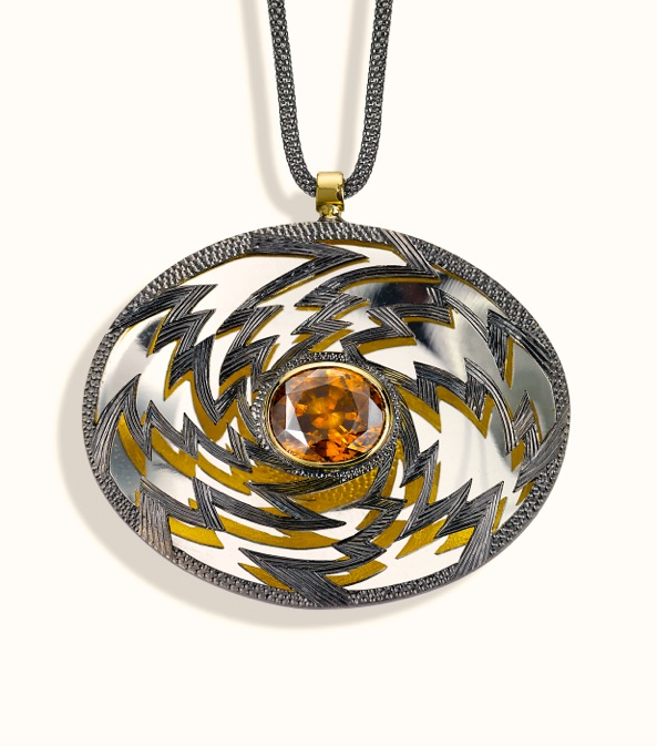 "<a href=""/node/261"">PENDENT ""Golden Lightening"" Oval 6cm x 4 cm. Silver hand engraved, hand pierced, mirror behind to reflect the underside.  Stone oval Zircon in orange / brown. set in 18ct gold.  View 2 Face on light reflections, White background</a>"
