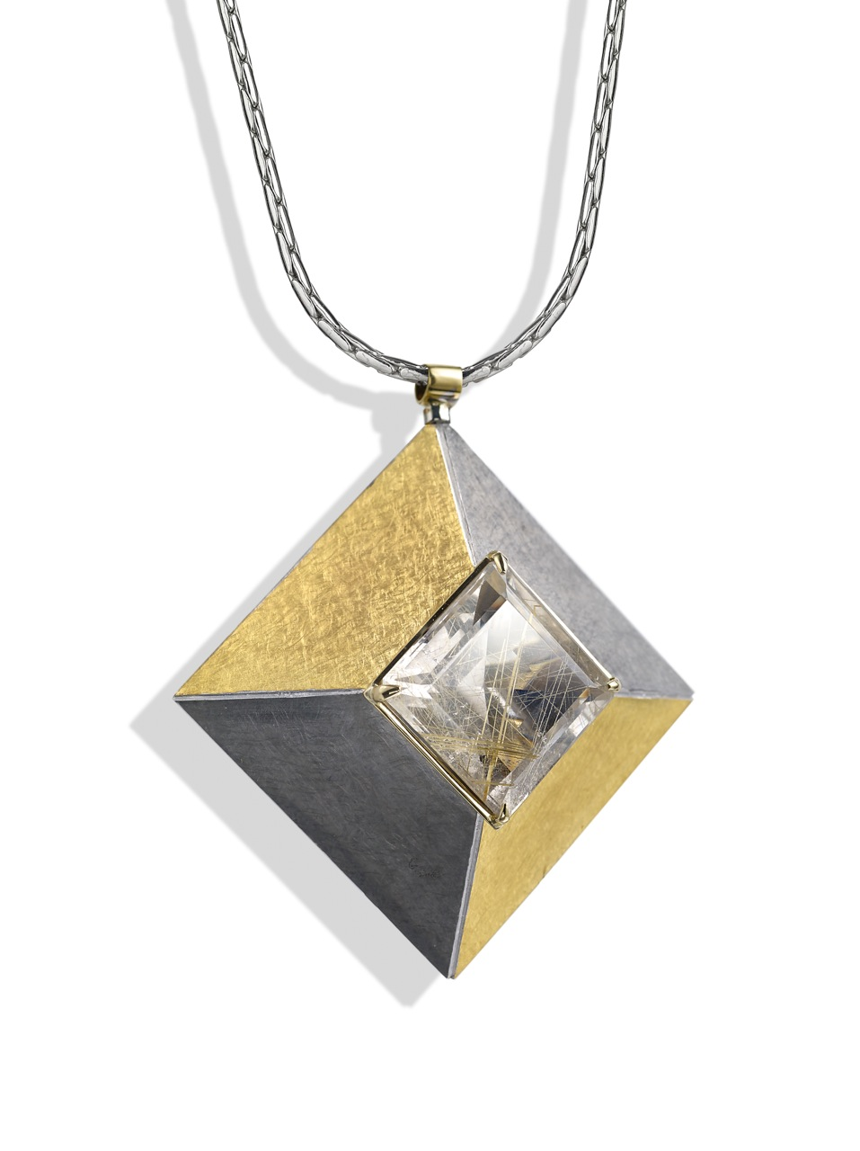"<a href=""/node/262"">Cardinal Points :  Silver 5.0cm square, scrubbed finish finished in Black Rhodium and gilding,  stone setting 18ct gold, stone Rutilated Quartz . View 2 : side on showing truncated pyramid form. </a>"