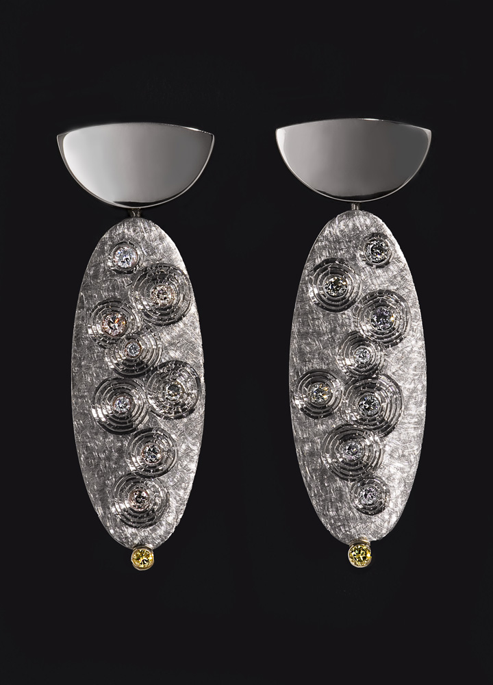 "<a href=""/jewellery/earrings-en-suite-golden-thread-brooch-18ct-white-gold-set-grey-diamonds-and-small-pair"">EARRINGS En Suite with &quot;GOLDEN THREAD BROOCH&quot;. 18ct white gold, set with grey diamonds and small pair yellow diamomds. 2008. Photo: Simon Armitt</a>"