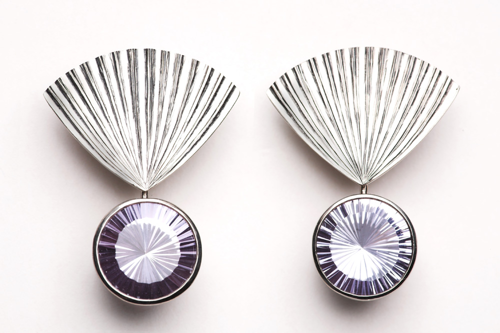 "<a href=""/jewellery/earrings-amethyst-fans18ct-white-gold-hand-carved-set-pair-sun-cut-pale-mauve-amethysts"">Earrings Amethyst Fans,18ct white gold hand carved set with pair ""sun"" cut pale mauve Amethysts. Pierced ear fittings.</a>"