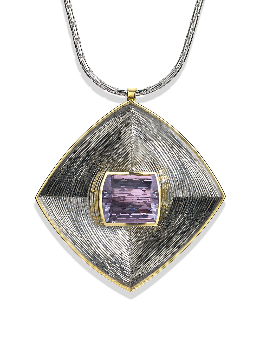 "<a href=""/node/271"">Square Pendent : Silver, hand engraved, Set with large Pale Amethyst in 18ct Gold. photo : Simon B Armitt</a>"