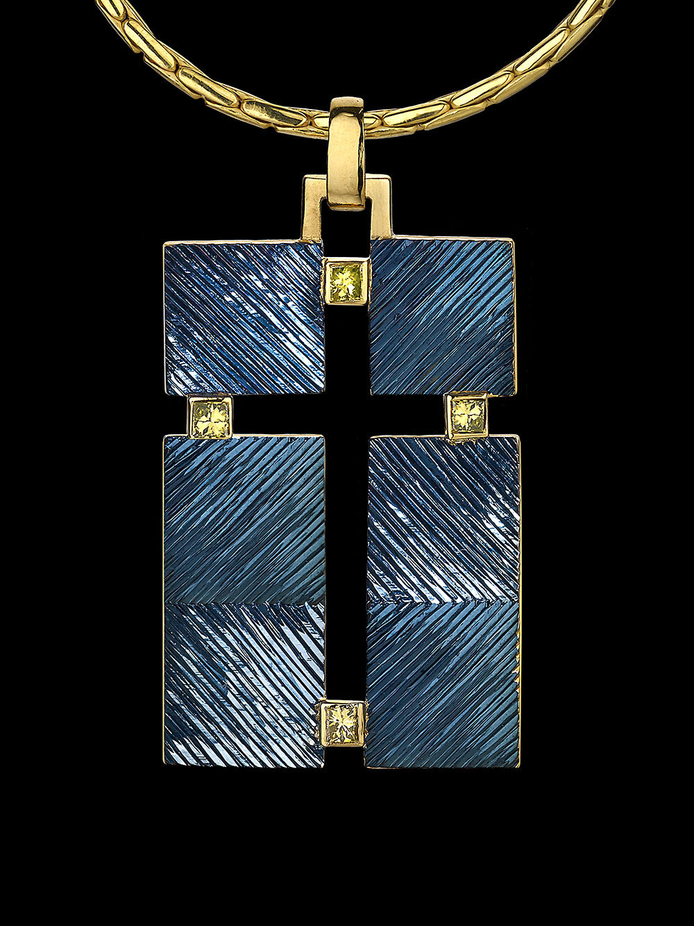 "<a href=""/node/270"">""THE CROSS THAT ISN&#039;T THERE""  Silver and 18ct gold, Gilding and Rhodium plate / Hand Engraved / Set with 4 square treated yellow diamonds. photo : Simon B Armitt 2017</a>"