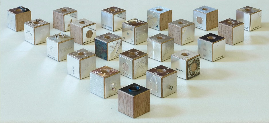 "<a href=""/jewellery/candleholders-gift-21-oak-cubes-goldsmiths-fair-exhibitors-providing-individual-squares"">Candleholders Gift  21 Oak Cubes with Goldsmiths Fair exhibitors providing individual squares to cover each side.  5.5cm square  photo : Simon B Armitt</a>"