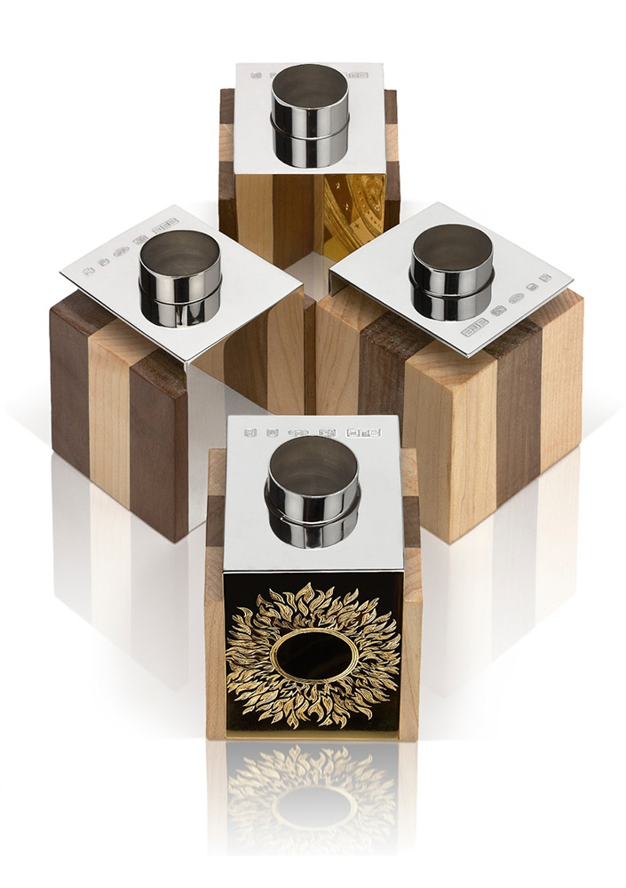 "<a href=""/jewellery/reflection-candelholders-reflection-candleholders-design-alan-craxford-two-pairs-each-cube"">Reflection Candelholders Reflection Candleholders Design by Alan Craxford.  Two pairs Each cube 5.5cm square. Silver finished in grey rhodium, part hand engraved, part gilded. Wood  English Walnut and Maple.</a>"