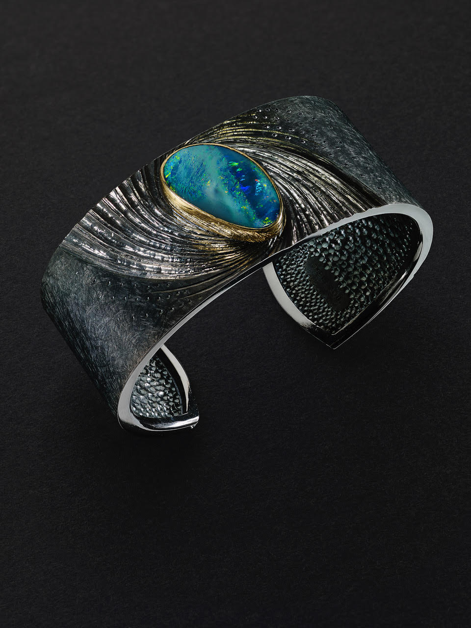 "<a href=""/node/278"">NewsCuff : Silver, hand engraved and black rhodium plated, Australian Opal set in 22 ct gold</a>"