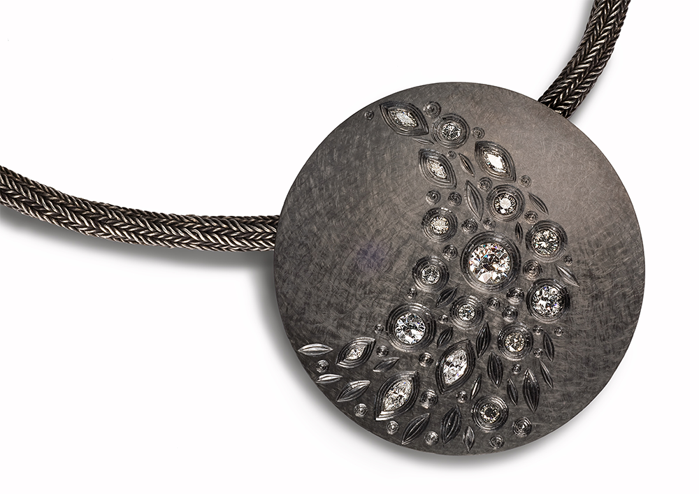 "<a href=""/jewellery/night-falling-stars-pendent-2008-9-60-mm-diam-silver-hand-engraved-finished-black-rhodium"">NIGHT OF THE FALLING STARS PENDENT 2008 / 9. 60 mm diam silver hand engraved finished in black rhodium, set with various white grey, brilliant, marquise and old cut diamonds. photo : simon b armitt.</a>"