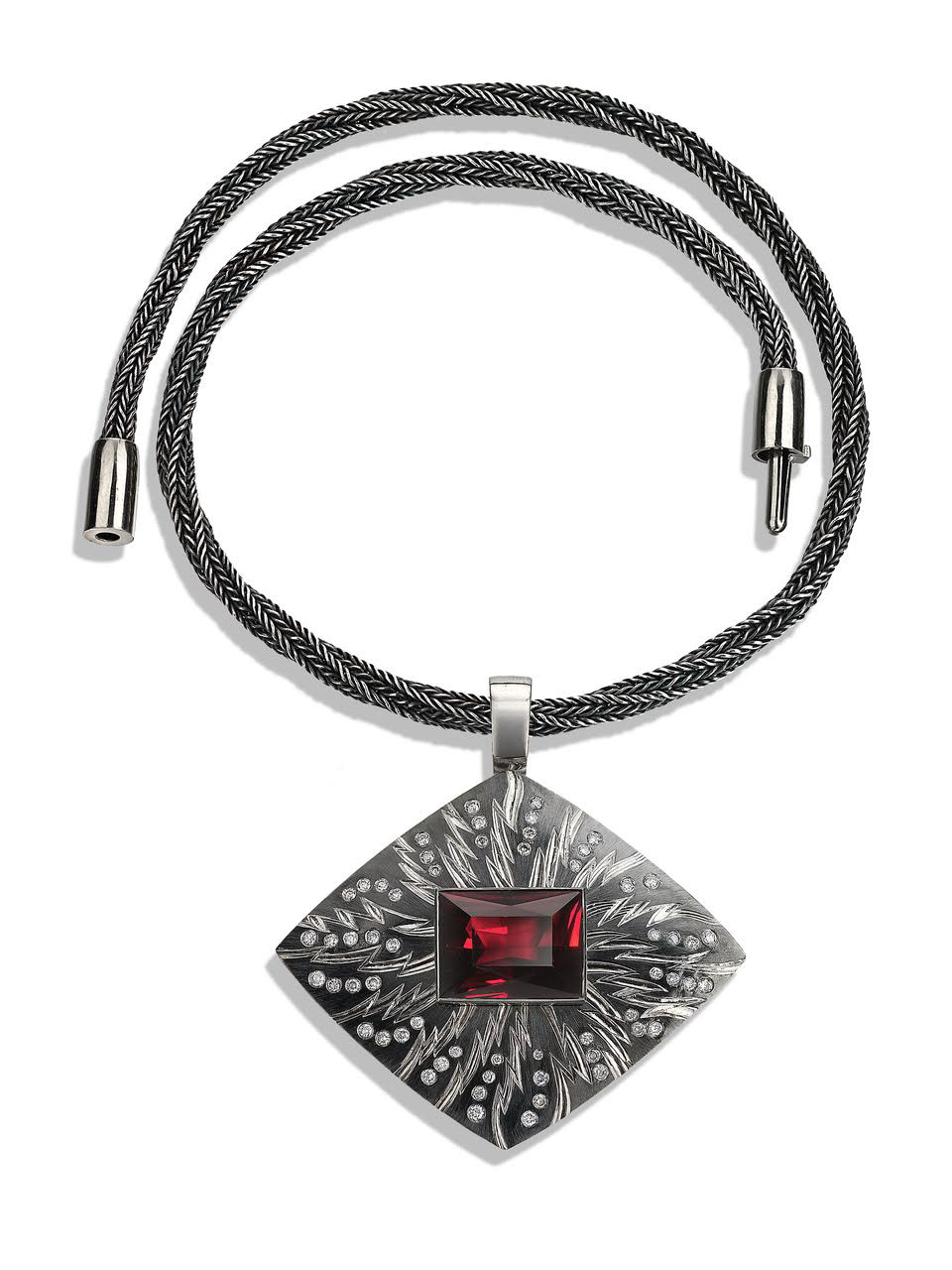 "<a href=""/node/277"">""PORTAL"" Pendent; 18ct white gold, hand engraved and carved, Set with 58 grey diamonds / rectangular Garnet 18.77cts. Part coloured in Black Rhodium. Hand knitted "" Sacred Knot"" chain in fine silver oxidised black' White Gold clasp / can be worn separatel</a>"