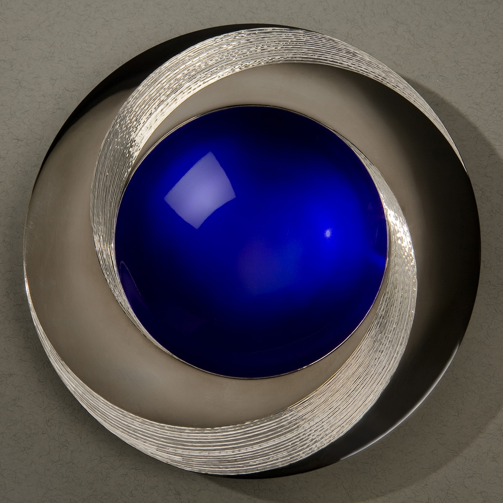 "<a href=""/jewellery/blue-infinity-bowl-150-mm-diameter-britannia-silver-blue-enamel-black-gilding-hand-0"">BLUE INFINITY BOWL 150 mm diameter. Britannia Silver. Blue Enamel, Black Gilding, Hand Engraved. Base frosted and polished Optical Quartz. Bowl is designed to spin gently on its stone base. Photo : Simon Armitt</a>"