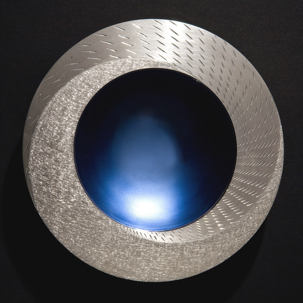 "<a href=""/jewellery/rain-spinning-bowl-2008-150-mm-diameter-brittannia-silver-moonstone-blue-enamel-white"">RAIN SPINNING BOWL 2008. 150 mm diameter. Brittannia Silver, Moonstone Blue enamel, white marble. Photo: Simon Armitt</a>"