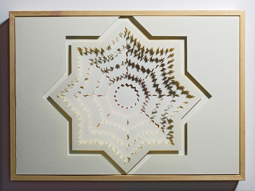 "<a href=""/jewellery/paper-cut-thoughts-eight-pointed-star-1-2010-watercolour-paper-board-crayon-and-wood-frame"">Paper Cut - Thoughts on an Eight Pointed Star 1 - 2010. Watercolour paper, board, crayon and wood frame. Work A3. out/dim/cm 44 x 32 x 5, photo Simon B Armitt</a>"