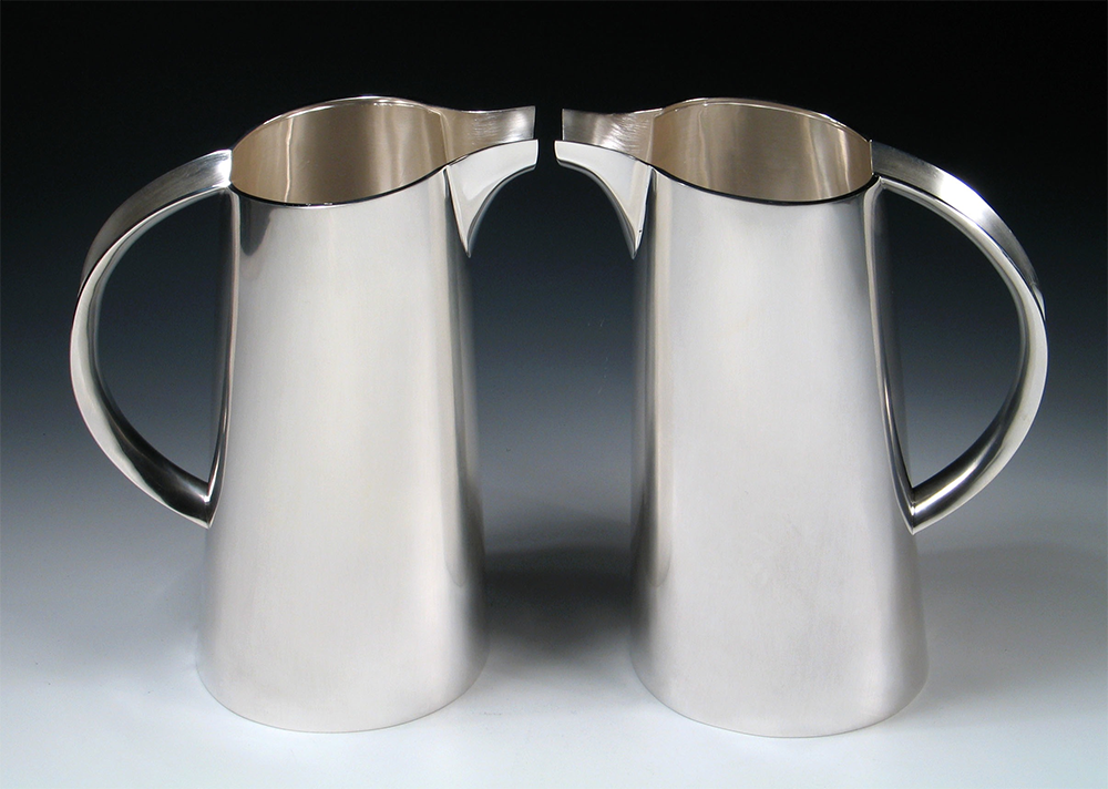 "<a href=""/jewellery/pair-water-jugs-commission-silver-photo-andra-nelki"">Pair of water jugs. Commission, silver. Photo: Andra Nelki</a>"